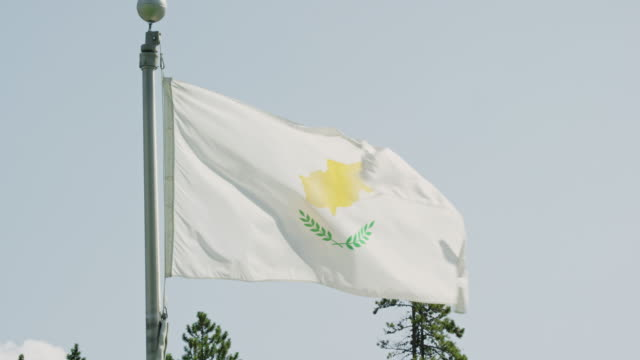 Slow Motion Shot of the Flag of Cyprus Blowing in the Wind on a Sunny Day
