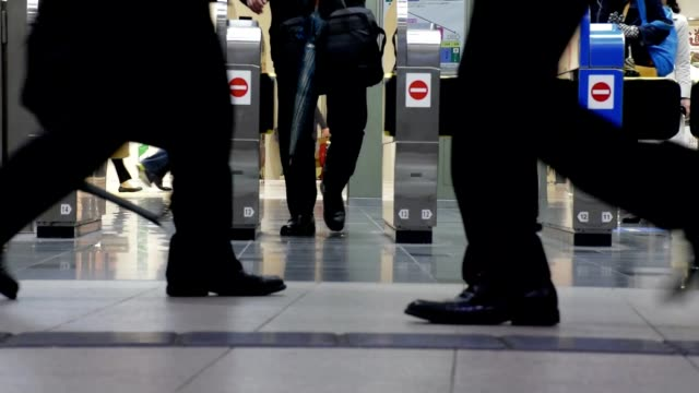 Slow motion shot of Traveler Crowd at Shin Osaka Station gate, Japan Slow motion shot of Traveler Crowd at Shin Osaka Station gate, Japan railroad station platform stock videos & royalty-free footage
