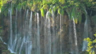 istock Slow Motion Shot of Waterfall inside a green forest, Plitvice Lakes National Park 1211177036
