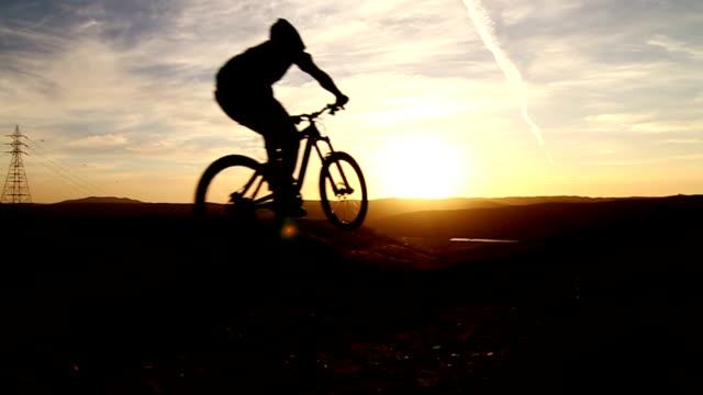 Slow Motion Silhouette Man Mountain Biking Off Extreme Jump video