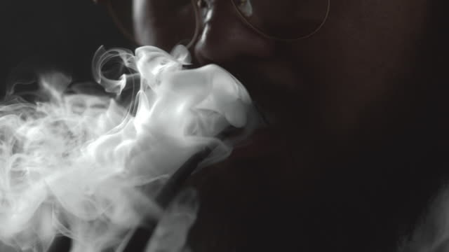 slow motion  : smoking - narcotico video stock e b–roll