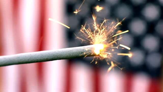 slow motion sparkler and american flag - independence day stock videos and b-roll footage
