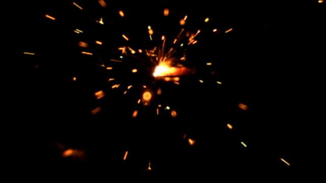 Slow motion sparkler burning