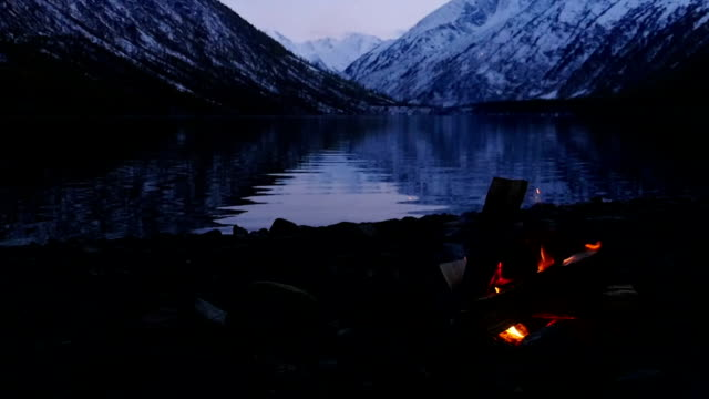 Slow Motion Stock Footage Campfire on the Lake Coas at Twilight Slow Motion Stock Footage Campfire on the Lake Coas at Twilight bonfire stock videos & royalty-free footage