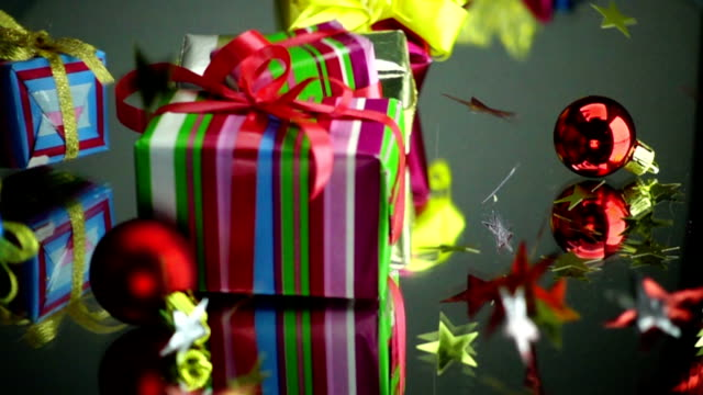 slow motion stock footage christmas gift boxes an stars falls on thetable - nastro per capelli video stock e b–roll