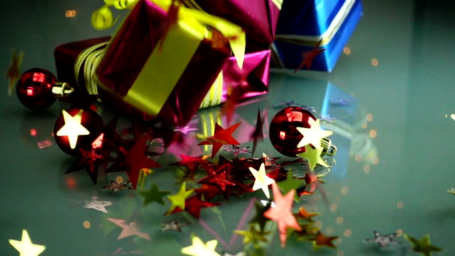 slow motion stock footage christmas gift boxes falls on thetable - nastro per capelli video stock e b–roll