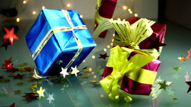 slow motion stock footage christmas gift boxes falls - nastro per capelli video stock e b–roll
