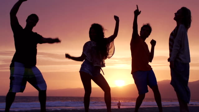slow motion sun dance - parties stock videos and b-roll footage