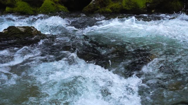 slow motion surface  water at the mountain river slow motion surface  water at the mountain river flowing water stock videos & royalty-free footage