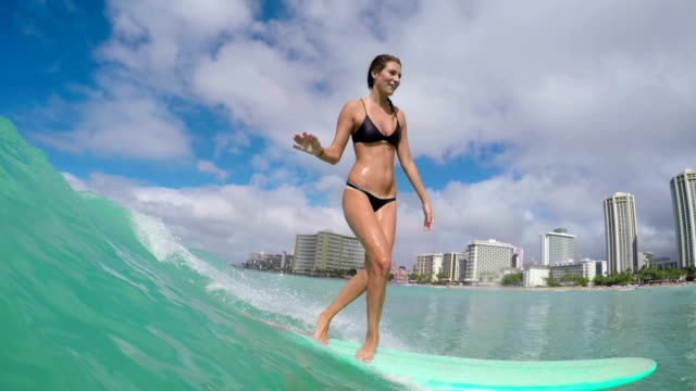 Slow Motion Surfer Girl Riding Wave On Summer Day video