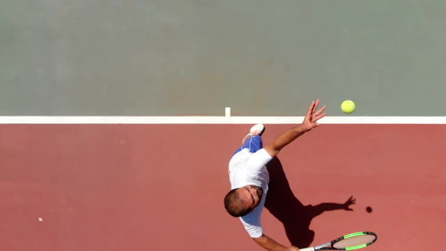 Slow Motion Tennis Player Captured by a drone sportsperson stock videos & royalty-free footage