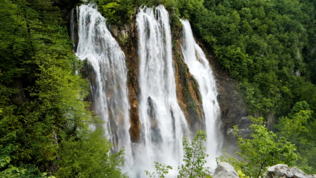 slow motion tilt down shot of veliki slap, the largest waterfall at plitvice - tilt down stock videos & royalty-free footage