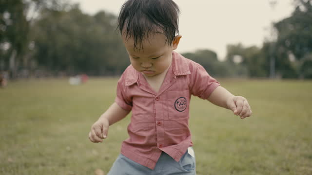 Slow Motion : Toddler running outdoor