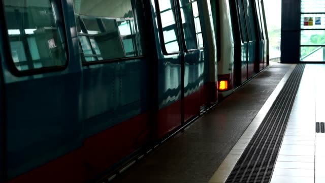 Slow Motion Train door closes and leaves station video