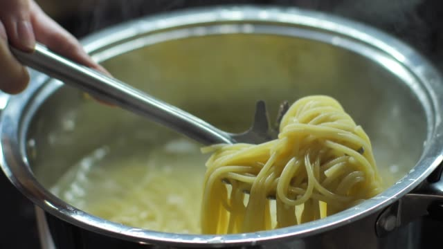 Slow motion video cooking spaghetti video