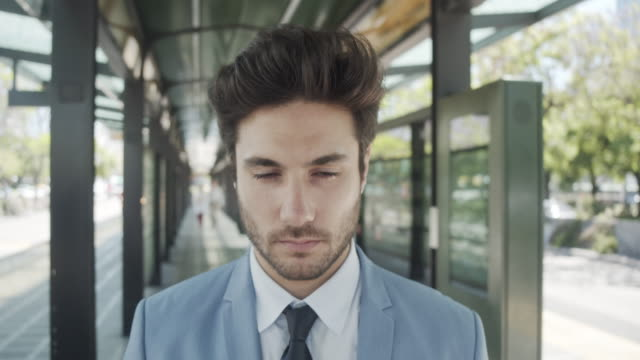 Slow motion video of a businessman opening his eyes and looking at camera video