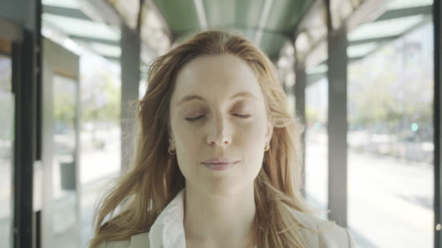 Slow motion video of a businesswoman opening her eyes and looking at camera Slow motion video of a businesswoman opening her eyes and looking at camera. She's at a bus station in Buenos Aires. eyes closed videos stock videos & royalty-free footage