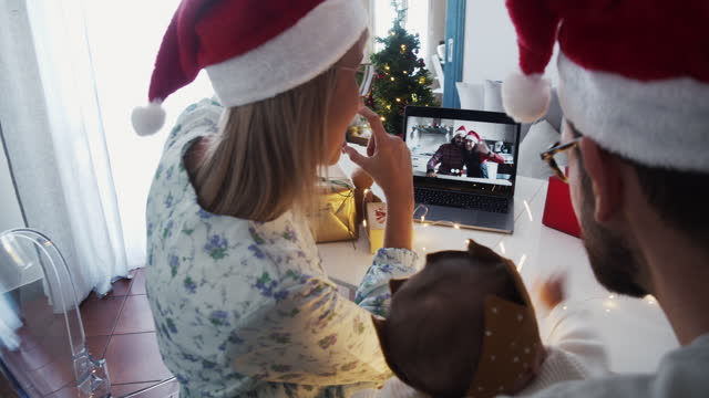 Slow motion video of a family celebrating Christmas with their relatives respecting social distancing video