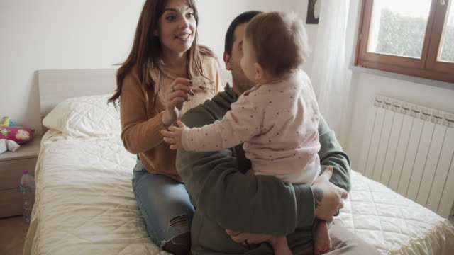 Slow motion video of a happy family together at home video
