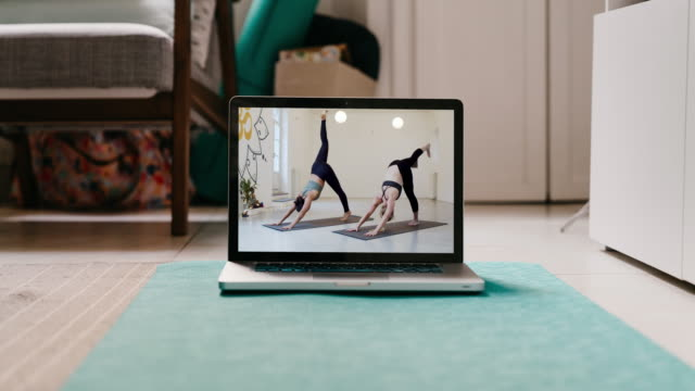 Slow motion video of a laptop ready for an online yoga video lesson video