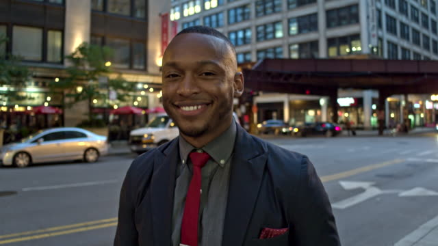 Slow motion video of a proud businessman in downtown Chicago video