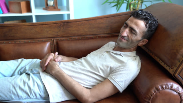 Slow Motion Video Of Adult Man Lying On Psychiatrist Couch While having Therapy video