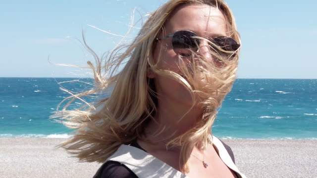 Slow Motion Video of Beautiful Woman at the Beach in a Windy Day