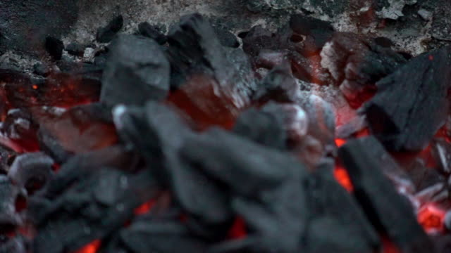 slow motion video of coal burning in a barbecue. - bbq stock videos and b-roll footage