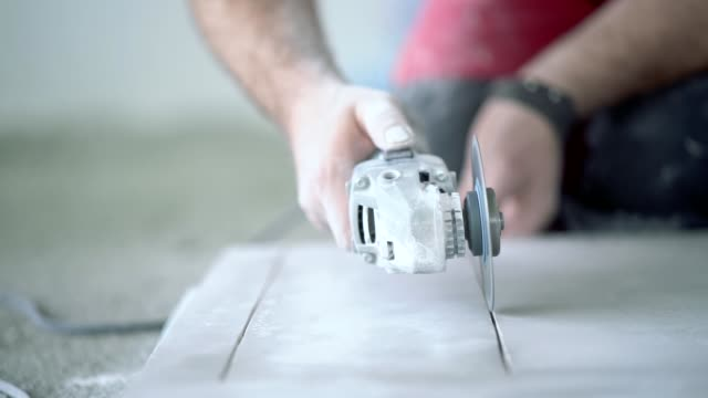 Slow motion video of cutting ceramic tile