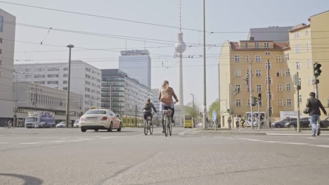 Slow motion video of people cycling in Berlin to work, Germany Slow motion video of people cycling in Berlin to work, Germany. cable car stock videos & royalty-free footage