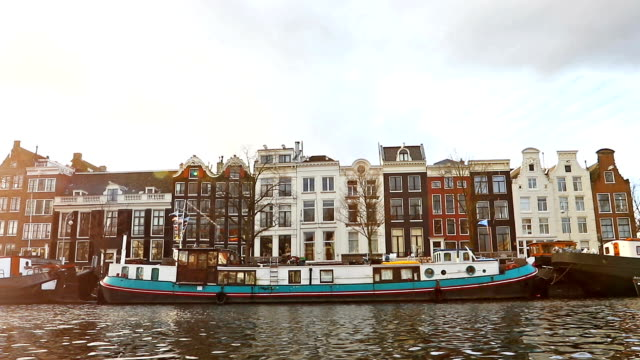 slow motion video of view from the canal to the streets. - amsterdam video stock e b–roll