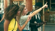 istock Slow motion video of young millennials friends having fun in the city 933166484