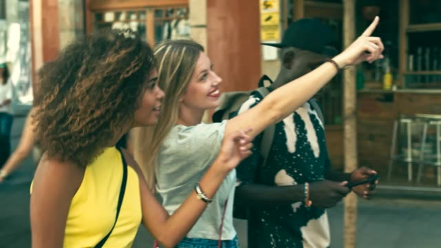 Slow motion video of young millennials friends having fun in the city Slow motion video of young millennials friends having fun in the city. guidance stock videos & royalty-free footage