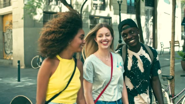 Slow motion video of young millennials friends in the city