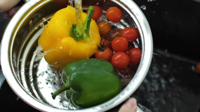 Slow motion video washing fresh peppers video