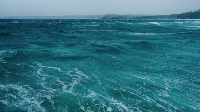 Slow motion view over rough sea at Newquay during a June storm. video