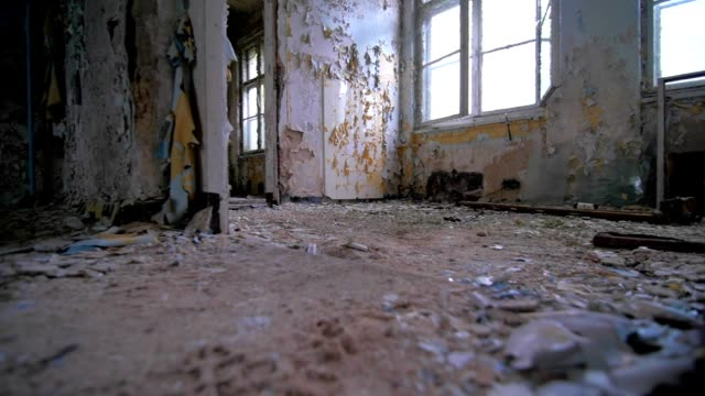 Slow motion walking through a cracked abandoned building Slow motion walking through a cracked abandoned building POV homeless person stock videos & royalty-free footage