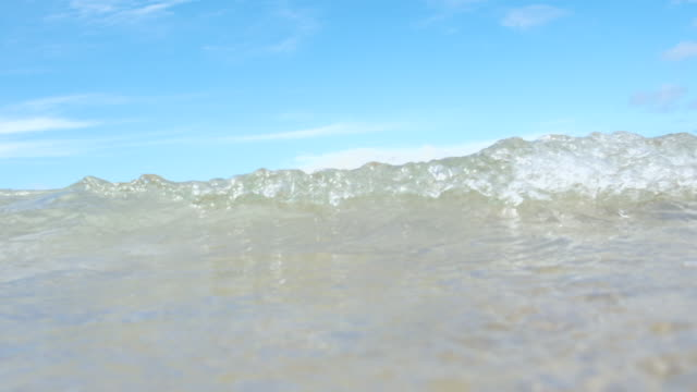 slow motion wave moving towards and over the camera, Fistral Beach, Newquay, Cornwall. video
