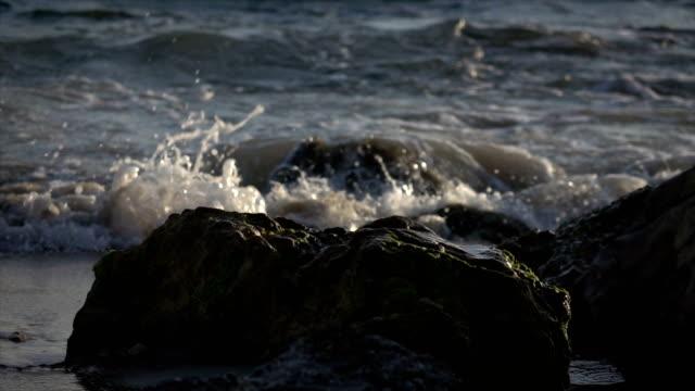 Slow Motion Waves Spilling Over Rocks video