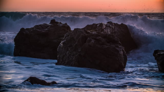 Slow Motion: Waves splashing on rocks, Big Sur - California video
