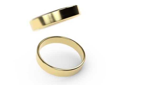 お互いの上に落ちるスローモーション結婚指輪 - 指輪点の映像素材/bロール