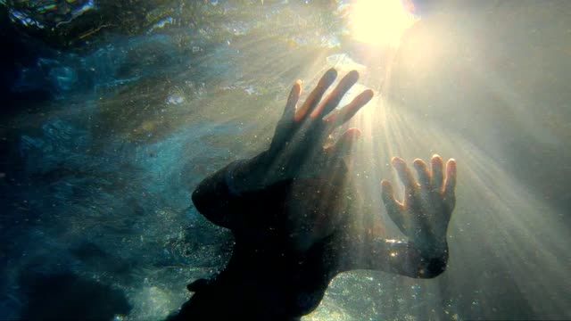 slow motion : woman in swimming pool swim underwater - sotto video stock e b–roll