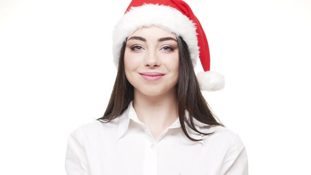 slow motion young attractive businesswoman blowing silver confetti celebrating for Christmas and New Year. video