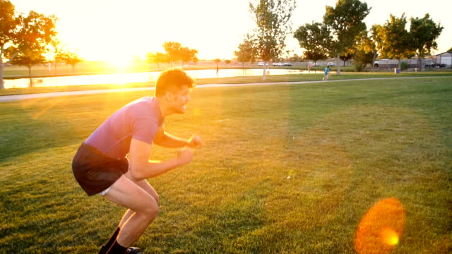 Slow Motion Young Man Doing Burpees in the Park video