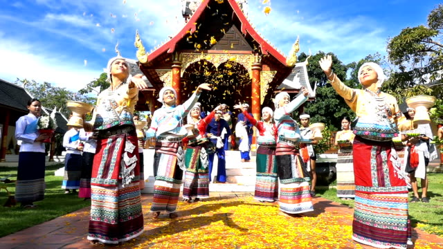 Slow Motion Young Men And Women Wear Traditionnel Thai Dress Dancing And Strew Orchid Flower In The Temple