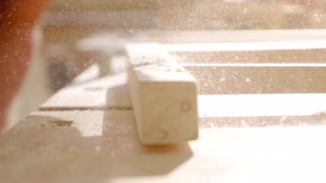 Slow motion:Blowing Dust from a plank video
