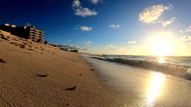 Slow Motion:Sunrise on tropical beach.
