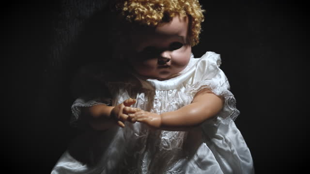 Slow Moving Close Up of Creepy Doll in the Dark