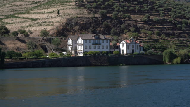 Slow pan across a Quinta or winery by terraced vineyard on the banks of the Douro river in Portugal - video