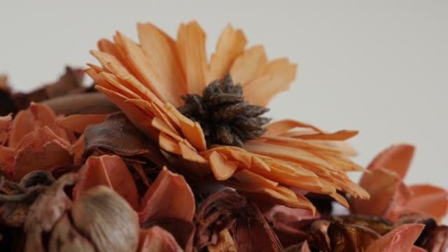 Slow pan on bowl with decorative orange flowers 4K